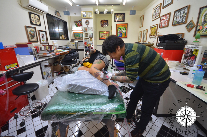 Rei working at Inkrat Tattoo